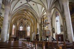 Church of Santa Maria Assunta. Fiera di Primiero, Italy, 06/20/2019 , Church of Santa Maria Assunta, dedicated to holy Mery. Cute little church on the historical royalty free stock photo