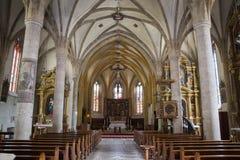 Church of Santa Maria Assunta. Fiera di Primiero, Italy, 06/20/2019 , Church of Santa Maria Assunta, dedicated to holy Mery. Cute little church on the historical royalty free stock photography