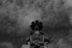 Fierce animal lion on the bridge holding the shield. Shot in black and white, detail on the sculpture on the facade of this historic building church representing royalty free stock photography