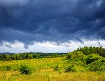 Fierce Black Storm Clouds moving in. Black dangerous looking clouds moving in over the fields before the storm hits royalty free stock photo