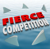 Fierce Competition Shark Fins Water Difficult Challenge Game. Fierce Competition words in 3d letters on water with shark fins as formidable competitors in a game Stock Image