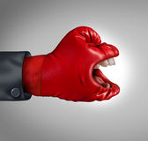 Fierce Competitor. Business concept as a communication symbol of making your voice heard as a red competitor boxing glove with a yelling human mouth screaming Stock Photos