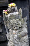 Fierce demon. Stone carving from Bali Indonesia Asia stock photography