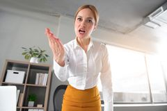 Fierce female arguing in office Stock Images