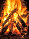 Fierce fire in the fire place Stock Photography
