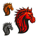 Fierce horse head chess stylized emblems. Fierce powerful horse head chess stylized emblems set. Vector icons of spiky fire mane for sport club emblem, team Royalty Free Stock Photo