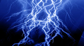 Fierce lightning. On a blue background Royalty Free Stock Image