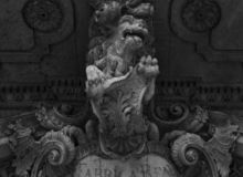 Fierce lion protecting the lion. Shot in black and white detail on the sculpture of this historic building representing some character, animal or flower. Set in stock photography