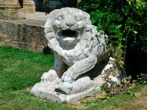 Fierce Lion Statue. Roman statue of lion with fierce expression, and pillars in background Stock Images