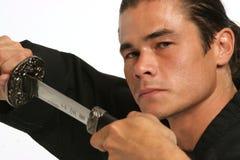 Fierce look over a sharp blade Royalty Free Stock Photos