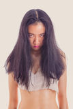 Fierce looking Asian teenage girl. Teenage Asian girl with fierce expression Royalty Free Stock Photography