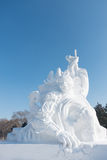 Fierce monkey man snow sculpture. Harbin,China – 01 20 2016:Fierce monkey man snow sculpture smashing the ground at the ice festival China royalty free stock photography