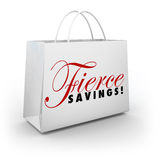 Fierce Savings Discount Sale Shopping Bag Buying Spree. Fierce Savings words on a shopping bag advertising a huge sale or discount clearance event Stock Image