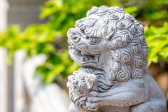 Fierce stone lion figure. Laoshan,China 21/04/2016 Fierce stone lion figure outside handrail decoration in a temple in Laoshan,China on a sunny day royalty free stock photography