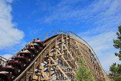 Fierce wooden roller coaster ride Stock Images
