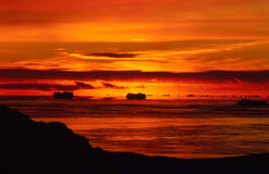 Fiery Antarctic Sunset. Silhouette of icebergs along the coast of Antarctica Royalty Free Stock Photos