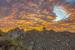 Fiery Arizona sunset over the Mcdowell Mountains in North Scottsdale, AZ. Fiery and epic  sunset over the rugged Mcdowell Mountains with colorful clouds in North stock images