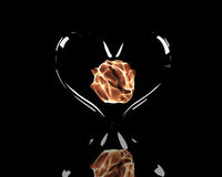 Fiery ball in glass heart. Abstract fiery ball burning in glass love heart, reflecting on black background Royalty Free Stock Images