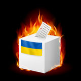 Fiery ballot box of Ukraine. Revolution sign. Ukranian ballot box in fire. Rebellion and revolution Stock Photography