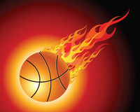 Fiery basketball ball. Flying downwards on a black background Stock Image