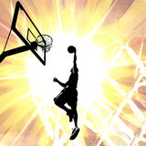Fiery Basketball Slam Dunk. Silhouette illustration of an athlete slam dunking a basketball over a fiery background Royalty Free Stock Photo