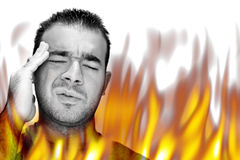 Fiery Burning Pain. A man experiencing pain and suffering with hot fiery flames burning around him Royalty Free Stock Photography