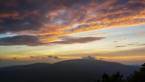 Fiery Catskill Mountain Sunset. A brilliant orange sunset and dramatic cloudscape looking west over the Catskill Mountains in New York State stock photo