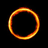 Fiery circle with sparkles and free space in center. Isolated on black background Stock Image