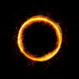 Fiery circle with sparkles and free space in center. Isolated on black background Stock Photo