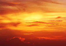 Fiery clouds of a Caribbean sunset Royalty Free Stock Images