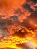 Fiery cloudy sunset sky. Fiery cloudy stormy bright orange sunset sky Royalty Free Stock Photography