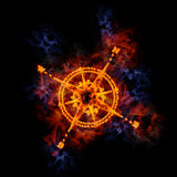 Fiery compass. Compass rose, covered in flames Royalty Free Stock Images