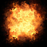 Fiery Exploding Burst Background. Realistic fiery explosion busting over a black background Stock Photo