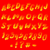 Fiery font. On a bright red background Royalty Free Stock Photos