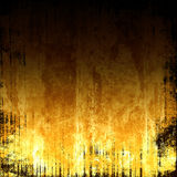 Fiery Grunge Background. Vivid and fiery orange and yellow tones grunge background abstract design with dark copyspace Stock Image