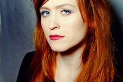 Fiery hair. Beautiful woman with red hair portrait Royalty Free Stock Photography