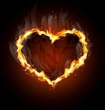 Fiery heart on a black background Stock Images