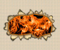 Fiery hole in a paper. Hole in a standard sheet and a flame behind a paper Stock Photos