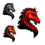 Fiery horse head icon for equestrian sport. Fiery orange horse head icon with tribal stylized spiky mane hairs. For equestrian sport, t-shirt print, tattoo or Royalty Free Stock Photography