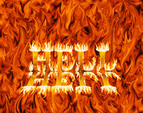 Fiery inferno with word hell emerging from it. In flames, with reflection Stock Images