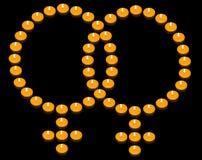 Fiery Lesbian Symbol. A group of burning candles forming a fiery lesbian symbol Royalty Free Stock Image