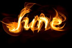 Fiery letters of the word June. On a black background Stock Image