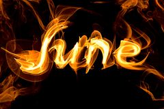 Fiery letters of the word June. On a black background Stock Photography