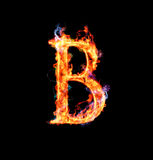 Fiery magic font - B. B- Capital letter made of fire and magic sparkles Royalty Free Stock Photography