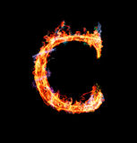 Fiery magic font - C. C- Capital letter made of fire and magic sparkles Stock Photos