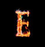 Fiery magic font - E. E- Capital letter made of fire and magic sparkles Royalty Free Stock Image