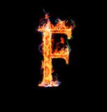 Fiery magic font - F. F- Capital letter made of fire and magic sparkles Royalty Free Stock Images