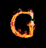Fiery magic font - G. G- Capital letter made of fire and magic sparkles Royalty Free Stock Image