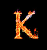 Fiery magic font - K. K- Capital letter made of fire and magic sparkles Royalty Free Stock Image