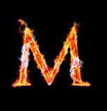 Fiery magic font - M. M- Capital letter made of fire and magic sparkles Stock Image